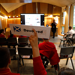 Pupil holding up sign in the Education Centre at Holyrood